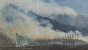 Smoke from the Silver fire envelopes above wind turbines in mountains near Palm Springs